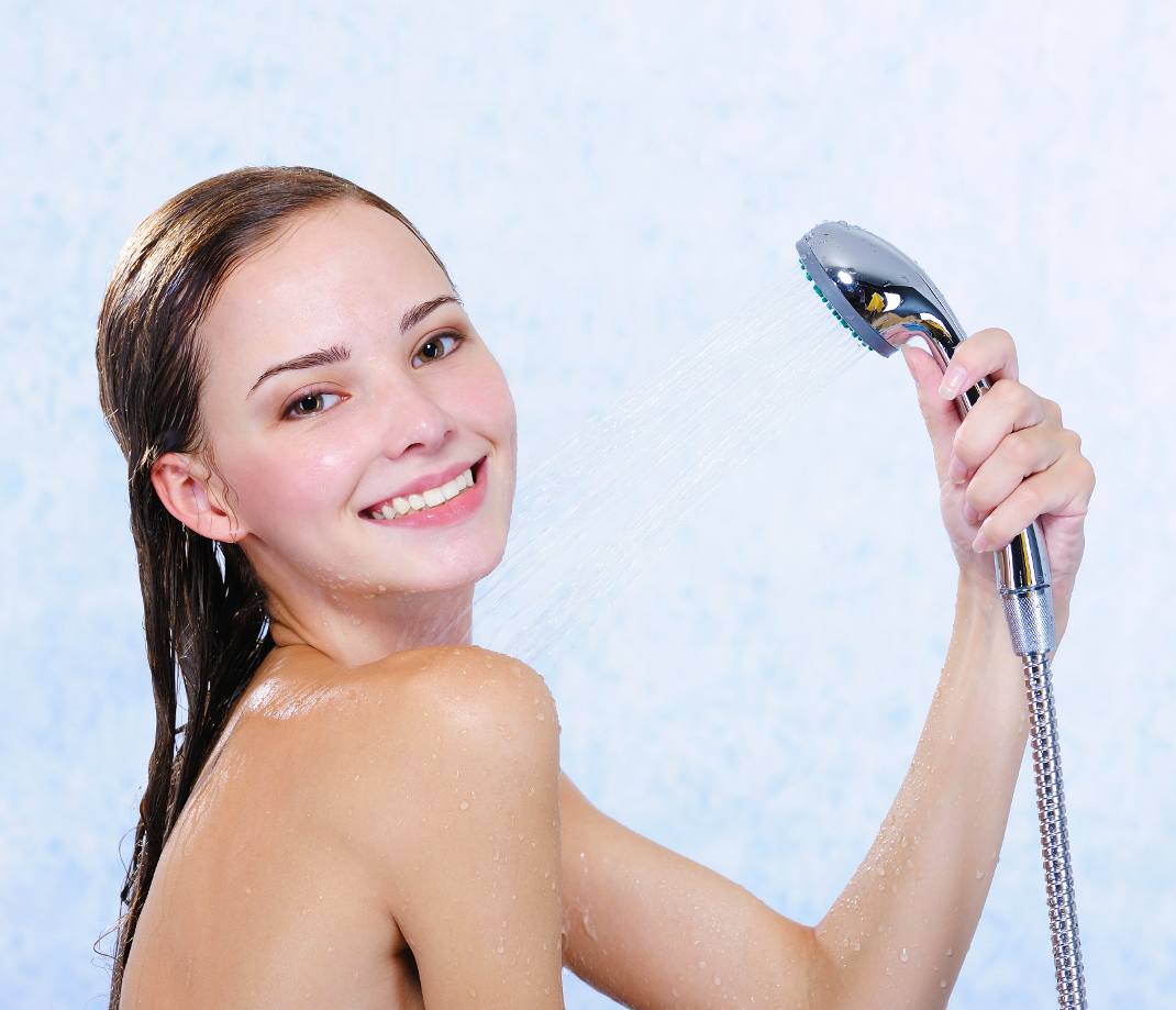Beautiful attractive happy naked girl taking shower