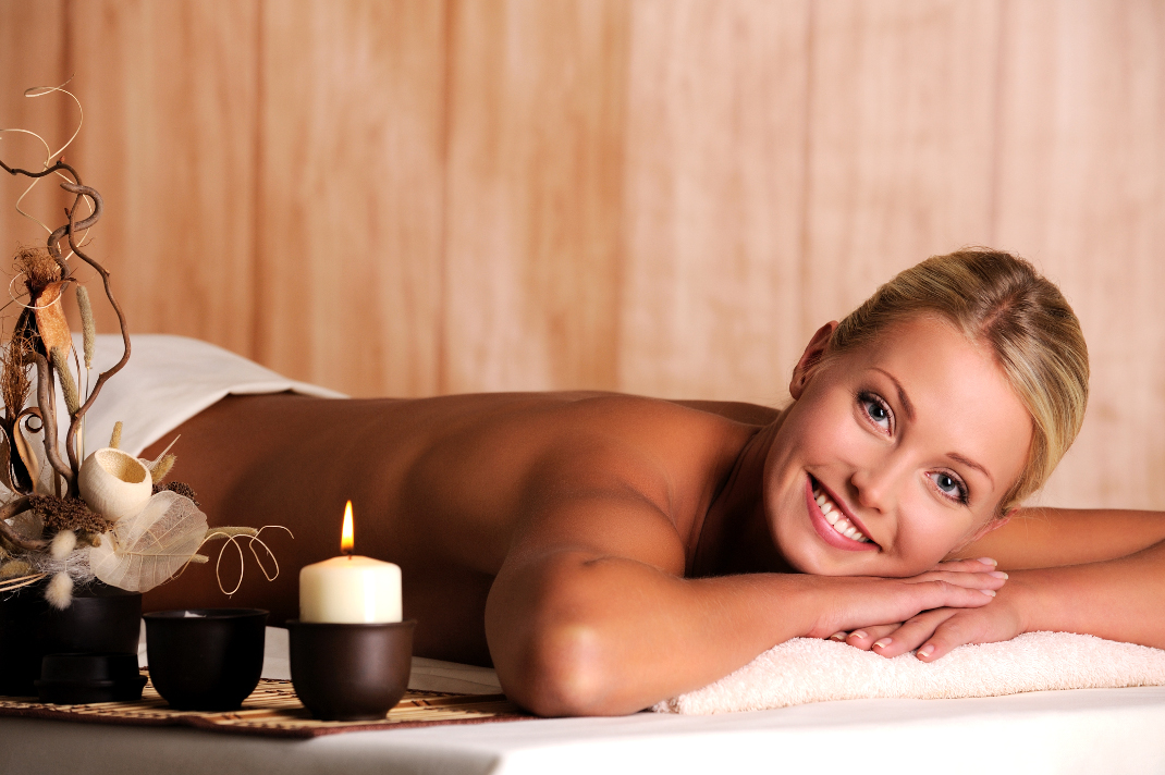 Beautiful smiling young woman relaxation in spa salon