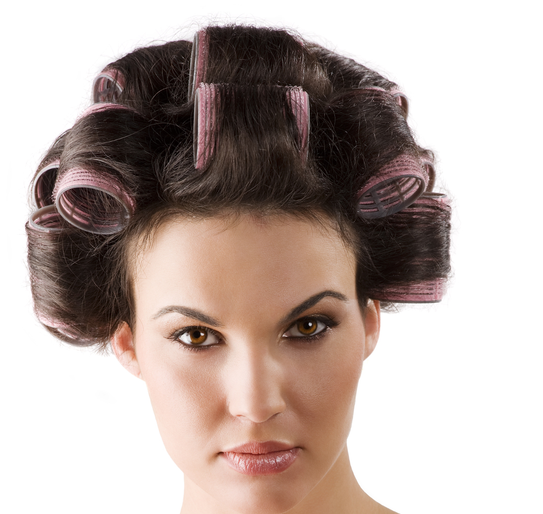 beauty portrait of a young brunette woman with hair curlers in her hair